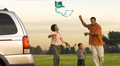 african american family flying a kite